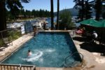 Knotty pine pool overlooking lake