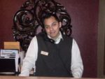 Salvador Garnica at the front desk