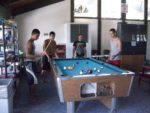 Kids from Pittsburg, Ca enjoy a game of pool.